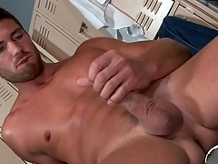 Hot guy strokes his uncut cock with a vengeance