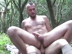 Several horny guys sucking each others cocks deep in the woods