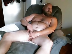 Dishy tramp is masturbating in the guest room with an increment of filming himself on high webcam