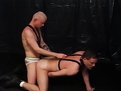 Twosome kinky gay lovers satisfying each other's desires prevalent the dungeon