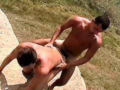 Muscled young guy turns over relative to stand for about a vicious rod of pleasure