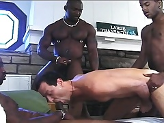 Handsome waxen boy has three hung dark studs pounding his anal hole